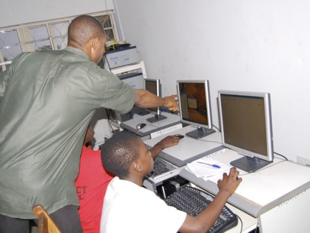 Computer education was also part of the program. For Adewale Oluwadunni, foreground in white shirt, this class was the first time she ever laid eyes on a computer.