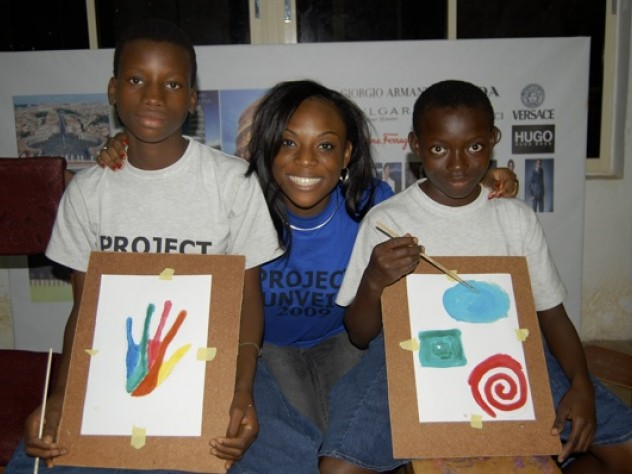Camp participants Alabi Dolapo and Ayoade Basirat show off their artwork.