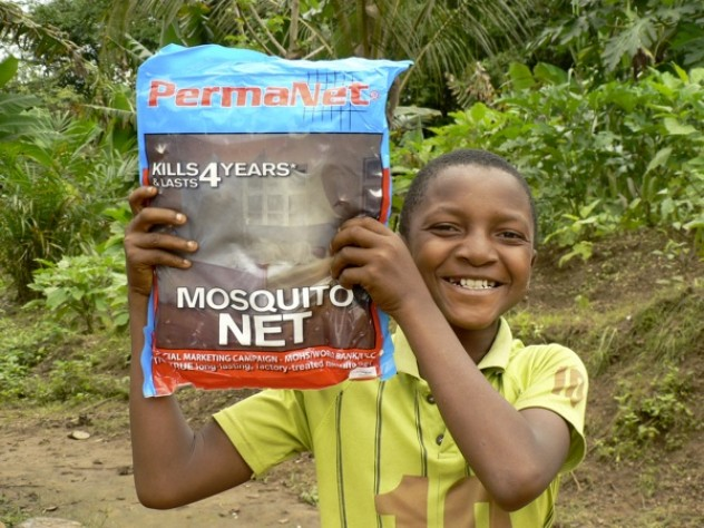 A young (and proud) recipient of a GMin mosquito net