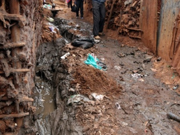 Walking in Kibera can be treacherous, but those who live or visit there quickly learn the rules of the game: step on dry ground when possible, and keep one's footing whatever the cost.