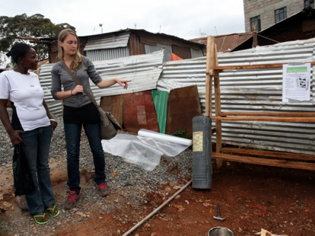 """Nowak discusses the prototype with Faith Mwikali, a social worker who translated for her, introduced her to community members, and helped her conduct her nutritional survey. Mwikali works with Binti Pamoja (""""Women Together"""" in Swahili), a Carolina for Kibera subsidiary that runs programs for women and girls."""