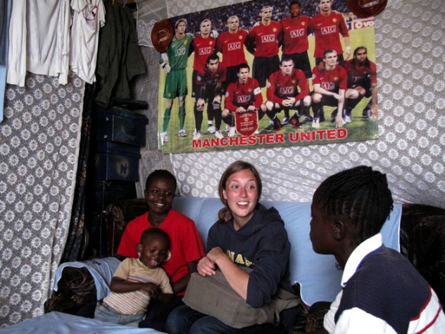 Nowak visits Obado's home. At left are Obado's son Carlos, and her sister.
