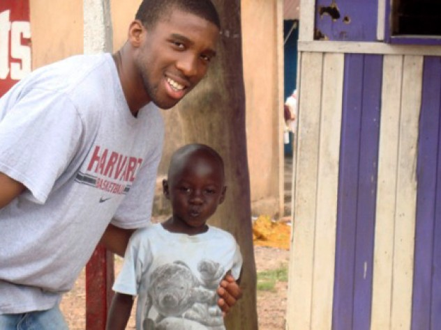Visiting in 2008 to oversee construction of a borehole and latrines, Ndu Okereke '10 (Project ACWA finance director, as well as a roommate of Delle and Finkton) hams it up with one of the village children.
