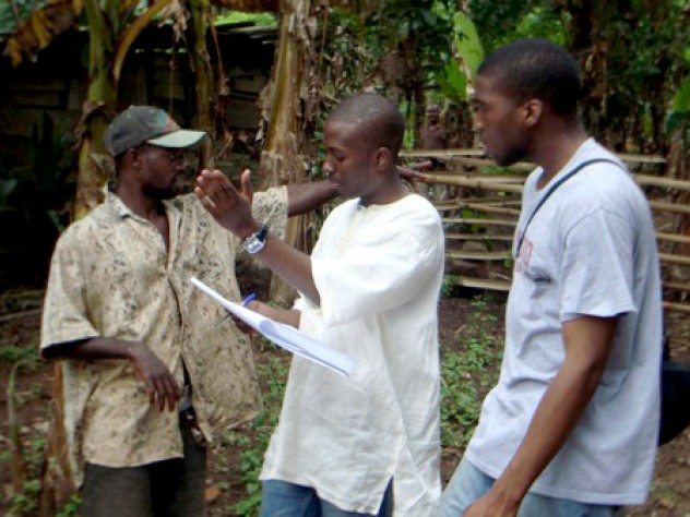 Delle, who grew up in Accra (24 kilometers south of Agyementi), discusses a latrine site with Okereke (right) and the youth representative from the village.
