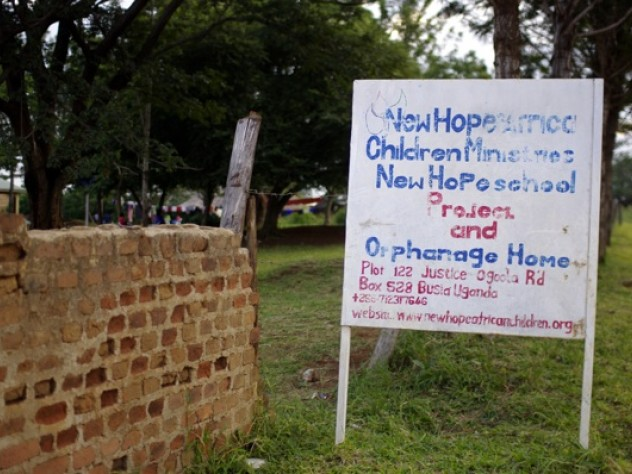 A sign on the road identifies the orphanage.