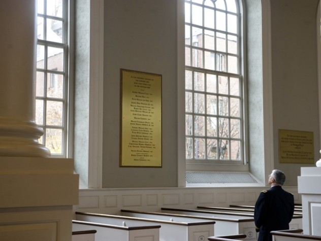 U.S. Army Chief of Staff George W. Casey Jr. views the plaque in Memorial Church honoring Harvard's Vietnam War dead—among them his father, George W. Casey '45.