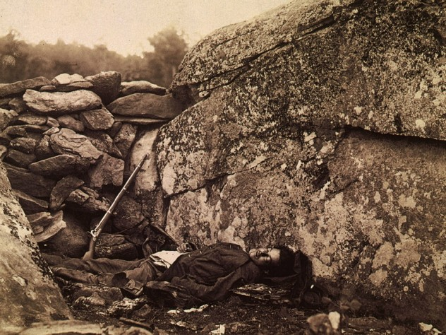 A fallen Civil War soldier with a rifle beside him, a scene that any contemporary viewer would have recognized as highly improbable