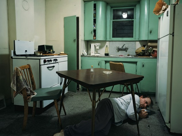 <em>Insomnia</em> (1994), by Canadian photographer Jeff Wall, is a completely staged cinematic photograph, set in an exact replica of the kitchen in Wall's studio. An actor portrays the victim of a nightmarish bout of insomnia.