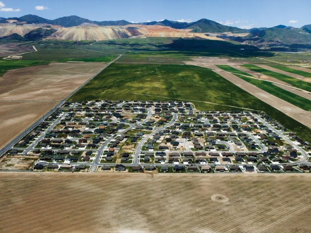 South Jordan, Utah - Isolated exurban communities built on cheap agricultural land depend on cars for nearly every activity. To access urban centers, residents often have to commute long distances. Because the land is virtually undeveloped, all aspects of modern infrastructure (water, sewer, electric, and roads) must be extended.