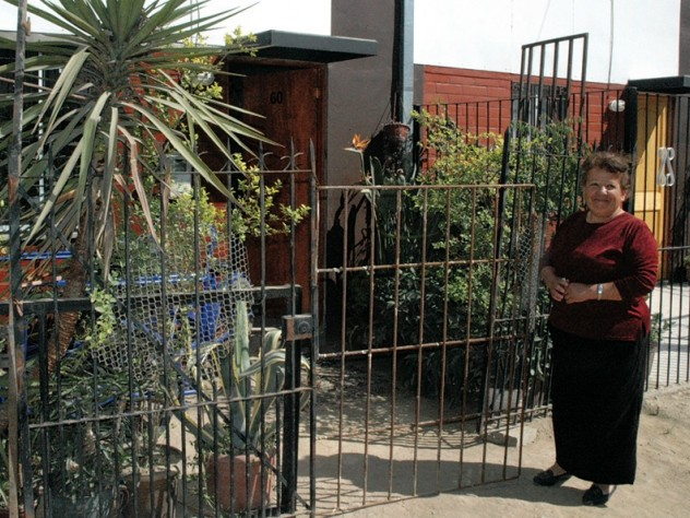 ...she has fenced in her front yard and filled it with plants, which she sells as her livelihood. And Ortega says this home, though unfinished, is a big improvement over her former makeshift home in the shantytown.