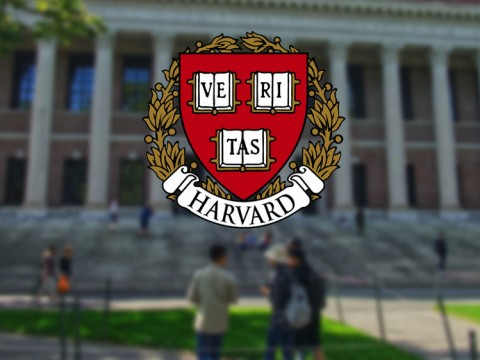 Harvard shield superimposed on image of Widener Library, a symbol of returning to operations