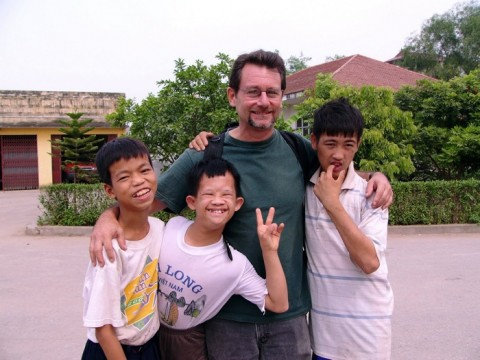 John Berlow with fellow residents of the Vietnam Friendship Village