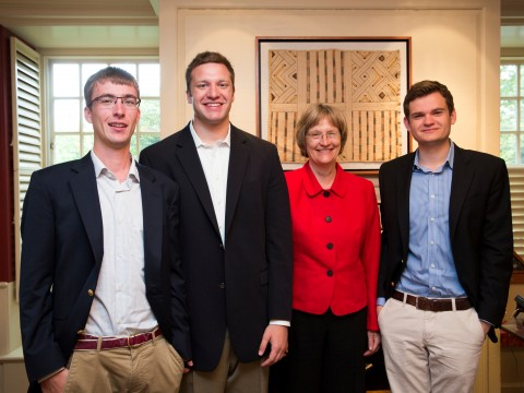 Harvard President Drew Faust greets the winners of the President's Challenge for social entrepreneurship in her office, in advance of the public announcement of their win. Florian Mayr '13 (from left), Matthew Polega '13, Drew Faust, and Scott Crouch '13 are pictured in Massachusetts Hall.