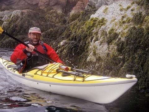 John Huth navigating through a rock slot of Placentia Island in coastal Maine