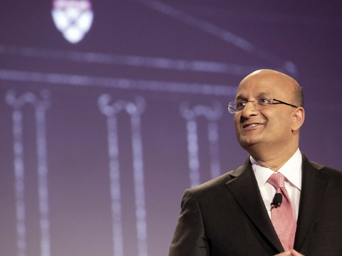 """Let's begin"": Business School dean Nitin Nohria during his campaign address April 25; a sketch of the iconic Baker Library is projected behind him."
