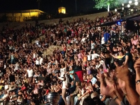 During Ramadan in Tunis, an undergraduate observes, the mood is celebratory and marked by a spirit of generosity. The photograph shows the audience dancing during a late-night traditional concert held at the Roman amphitheater in Carthage, Tunis.