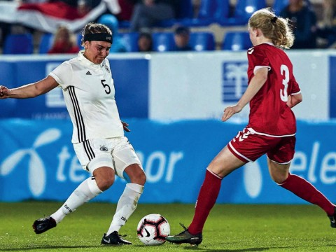 Linda Liedel (at left), representing Germany in Spain's 2019 La Manga Tournament, competes for the ball with a Danish rival.
