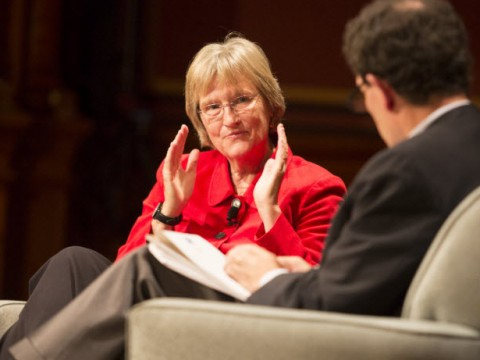 Journalist Nicholas Kristof in conversation with President Drew Faust in Sanders Theatre