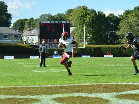 Pursued in vain by Brown's Will Twyman, Harvard quarterback Joe Viviano scampered for his second touchdown.