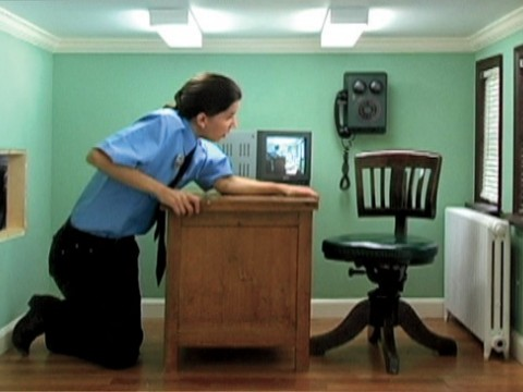 A scene from Meredith James's video <i>Day Shift </i>, starring James herself