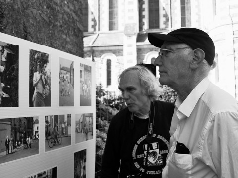 Peter Winship (left) and Bill Christian examine photographs recalling their days as student researchers in the village of Chanzeaux, under the tutelage of the late Laurence Wylie.