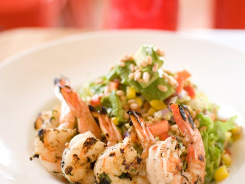 Grilled shrimp adds color to The Omega, a salad with avocado, corn, and cilantro.