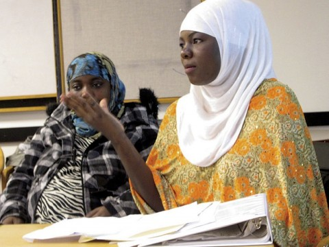 Zahara Haji (foreground) and Amina Abdullahi, research assistants in Betancourt's project with the Somali Bantu refugee community in Boston, during a presentation at Chelsea City Hall