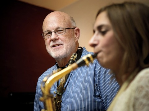 John Payne teaches a saxophone student at his music center in Brookline, Massachusetts.