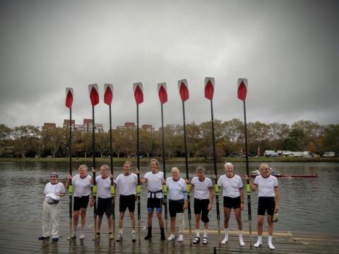 Oars raised after the race: (from left) Hugh Crane, Garrett Olmsted, Gib Vincent, Roger Cheever, Scott Steketee, Phil Tonks, Bobby Baker, Bill Endicott, and Gerry Goulet.