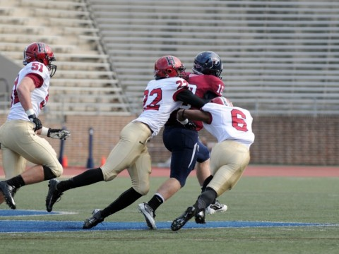 Linebacker Jacob Lindsey (51) trails the play as safety Reynaldo Kirton (22) and cornerback Brian Owusu (6) bring down Penn quarterback Billy Ragone. Ragone rushed for 95 yards and a touchdown, passing for two more Quaker scores in a 30-21 upset.