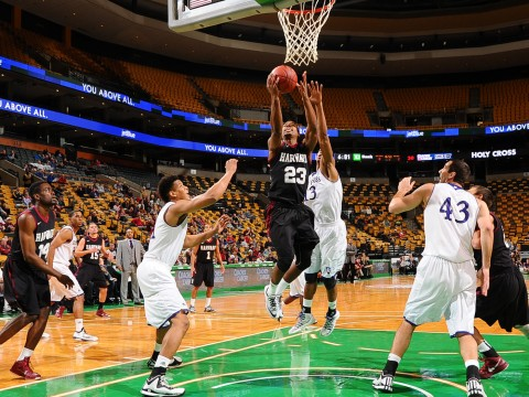 Senior Wesley Saunders eases in for a layup against Holy Cross last Sunday at Boston's T.D. Garden. Saunders has led Harvard in scoring through this season's first three games, averaging 19.3 points per contest..