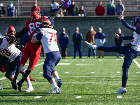 Penn's kicker, Jake Haggard, punts the football.