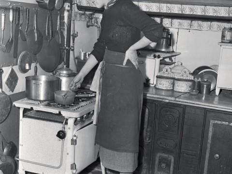 Child in her postwar Paris kitchen