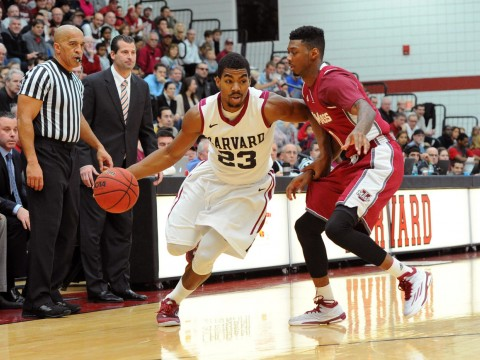 Senior Wesley Saunders (shown here, driving to the basket) led Harvard to victory with a game-high 27 points.