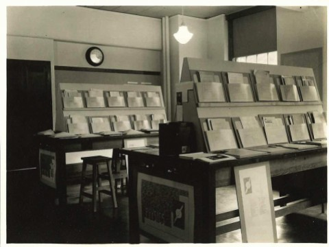 An historic photograph from Radcliffe's Schlesinger Library archives shows the 1936 exhibition on women scientists—in this case, folders of their published scholarship.